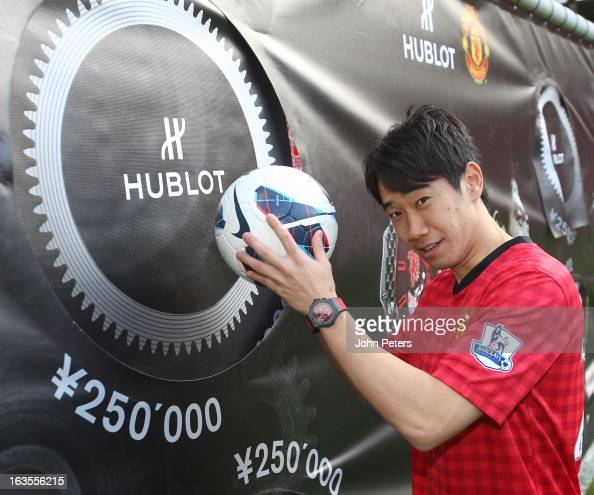 Shinji Kagawa of Manchester United takes part in a Hublot charity shooting event at Old Trafford on March 12 2013 in Manchester England
