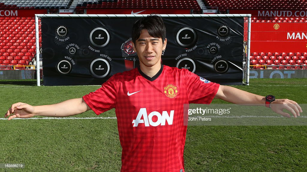 <a gi-track='captionPersonalityLinkClicked' href=/galleries/search?phrase=Shinji+Kagawa&family=editorial&specificpeople=4314029 ng-click='$event.stopPropagation()'>Shinji Kagawa</a> of Manchester United takes part in a Hublot charity shooting event at Old Trafford on March 12, 2013 in Manchester, England.