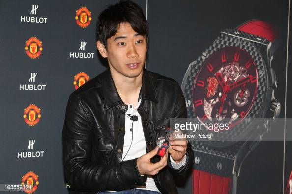 Shinji Kagawa of Manchester United takes part in a press conference taking part in a Hublot charity shooting event at Old Trafford on March 12 2013...