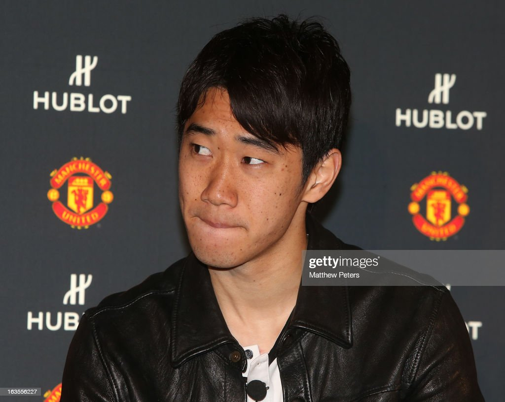 <a gi-track='captionPersonalityLinkClicked' href=/galleries/search?phrase=Shinji+Kagawa&family=editorial&specificpeople=4314029 ng-click='$event.stopPropagation()'>Shinji Kagawa</a> of Manchester United takes part in a press conference taking part in a Hublot charity shooting event at Old Trafford on March 12, 2013 in Manchester, England.