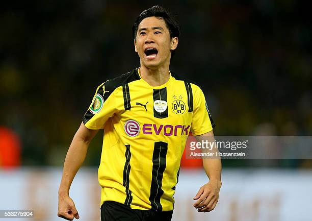 Shinji Kagawa reacts during the DFB Cup Final 2016 between Bayern Muenchen and Borussia Dortmund at Olympiastadion on May 21 2016 in Berlin Germany