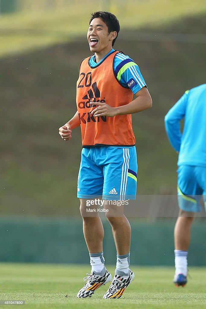 Shinji Kagawa sticks out his tongue as he laughs during a Japan training session at the Japan national team base camp at the Spa Sport Resort on June 22, 2014 in Itu, Sao Paulo.