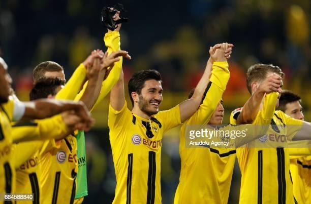 Shinji Kagawa Sven Bender Nuri Sahin and Emre Mor of Dortmund celebrate the 30 victory against Hamburg during the Bundesliga soccer match between...