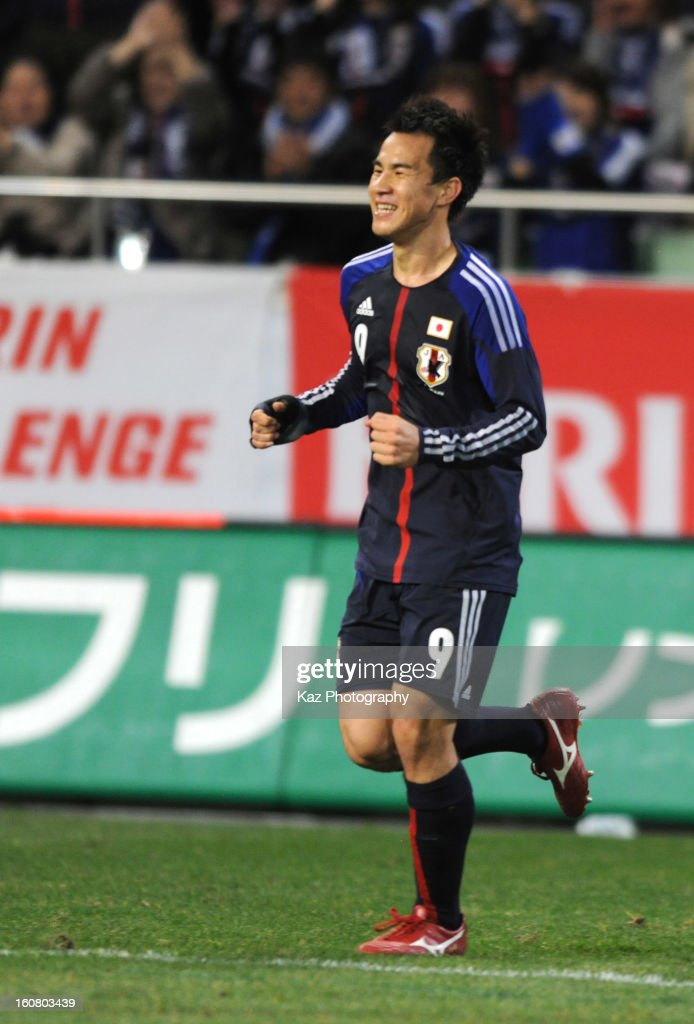 Shinji Oakazak of Japan celebrates his 2nd goal(Japan's 3rd goal) during the international friendly match between Japan and Latvia at Home's Stadium Kobe on February 6, 2013 in Kobe, Japan.