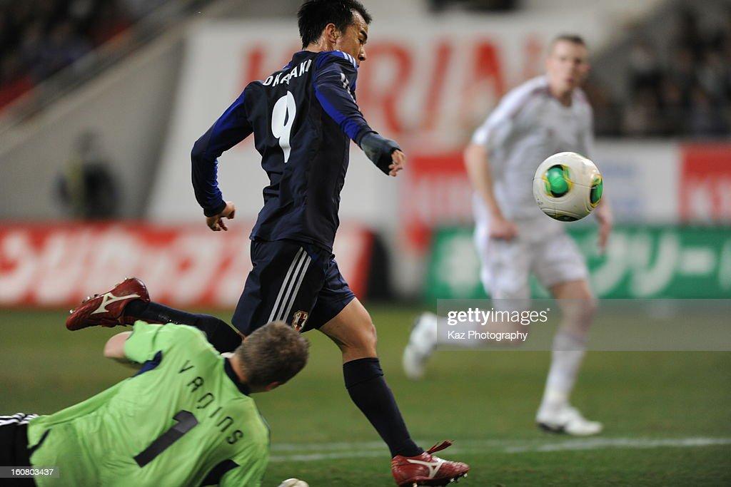 Shinji Oakazak of Japan scores his 2nd goal(Japan's 3rd goal) during the international friendly match between Japan and Latvia at Home's Stadium Kobe on February 6, 2013 in Kobe, Japan.