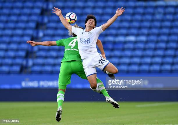 Shinji Okazak of Leicester is challenged by Jannik Vestergaard of Borussia Moenchengladbach during the preseason friendly match between Leicester...