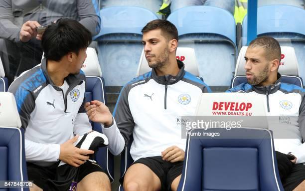 Shinji Okazaki Aleksandar Dragovic and Islam Slimani of Leicester City on the bench at John Smith's Stadium ahead of the Premier League match between...