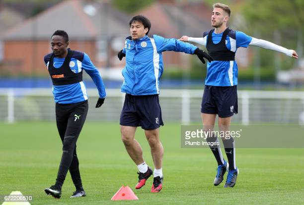 Shinji Okazaki and Ahmed Musa during the Leicester City training session at Belvoir Drive Training Complex on April 24 2017 in Leicester United...