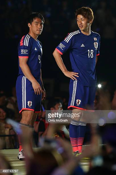 Shinji Okazaki and Yuya Osako of Japan meet with fans during the World Cup sendoff press conference for Japanese team on May 25 2014 in Tokyo Japan