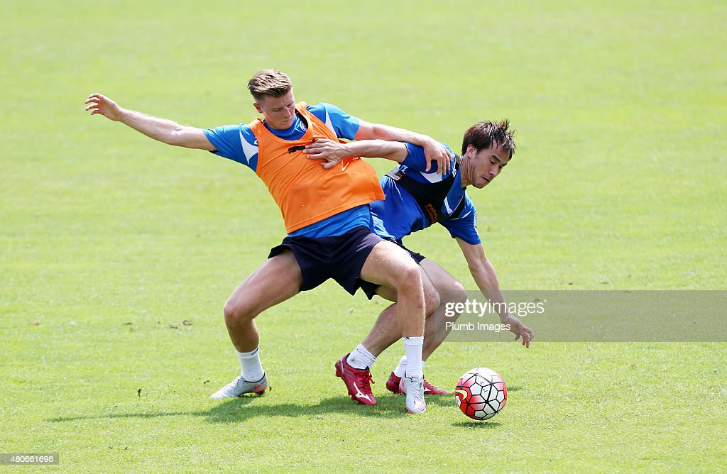 Shinji Okazaki hold off Jack Barmby during the Leicester City training session at their pre-season training camp on July 14, 2015 in Spielfeld, Austria.