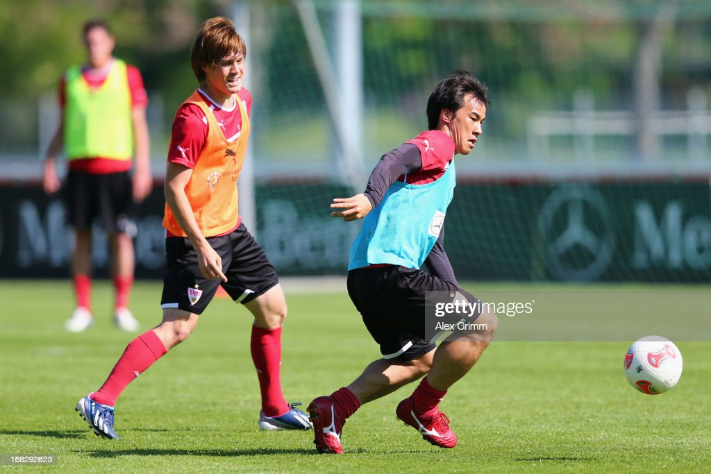 <a gi-track='captionPersonalityLinkClicked' href=/galleries/search?phrase=Shinji+Okazaki&family=editorial&specificpeople=4320771 ng-click='$event.stopPropagation()'>Shinji Okazaki</a> (R) is challenged by <a gi-track='captionPersonalityLinkClicked' href=/galleries/search?phrase=Gotoku+Sakai&family=editorial&specificpeople=7015160 ng-click='$event.stopPropagation()'>Gotoku Sakai</a> during a VfB Stuttgart training session at the club's premises on May 8, 2013 in Stuttgart, Germany.