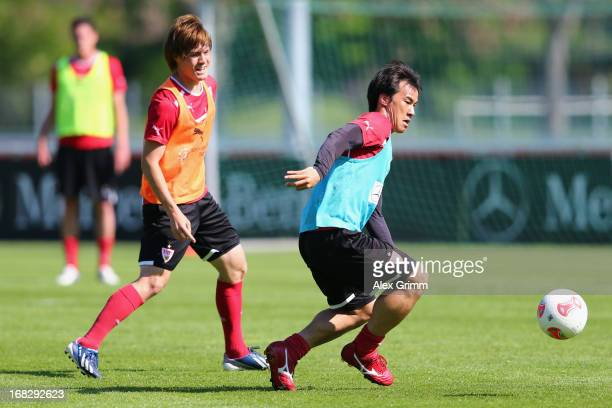 Shinji Okazaki is challenged by Gotoku Sakai during a VfB Stuttgart training session at the club's premises on May 8 2013 in Stuttgart Germany