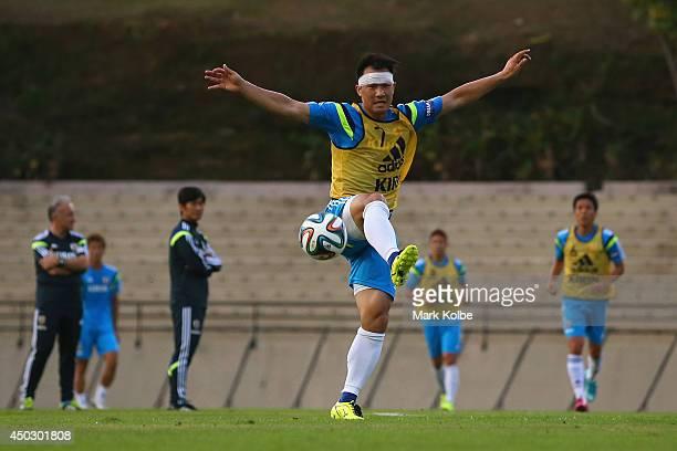 Shinji Okazaki kicks during a Japan training session held at Walter Riberio Stadium on June 8 2014 in Sorocaba Sao Paulo