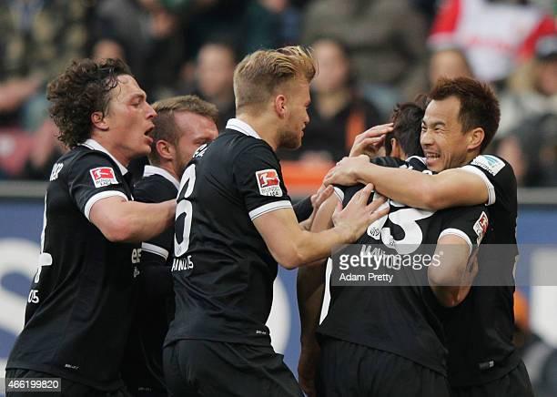 Shinji Okazaki of FSV Mainz 05 congratulates JaCheol Koo after he scores the second goal during the Bundesliga match betwen FC Augsburg and FSV Mainz...