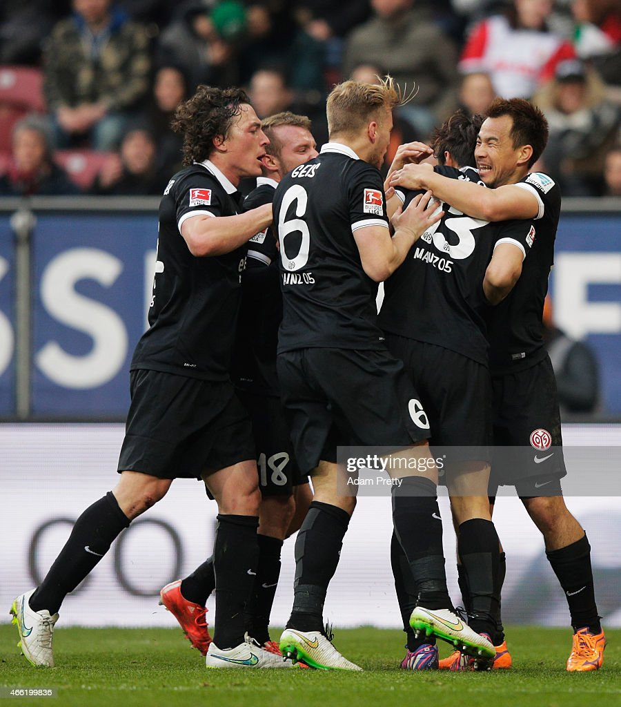 <a gi-track='captionPersonalityLinkClicked' href=/galleries/search?phrase=Shinji+Okazaki&family=editorial&specificpeople=4320771 ng-click='$event.stopPropagation()'>Shinji Okazaki</a> of FSV Mainz 05 congratulates Ja-Cheol Koo after he scores the second goal during the Bundesliga match betwen FC Augsburg and FSV Mainz 05 at SGL Arena on March 14, 2015 in Augsburg, Germany.