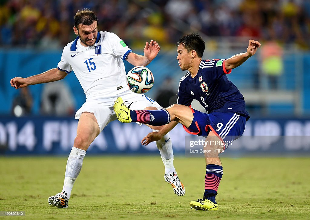 <a gi-track='captionPersonalityLinkClicked' href=/galleries/search?phrase=Shinji+Okazaki&family=editorial&specificpeople=4320771 ng-click='$event.stopPropagation()'>Shinji Okazaki</a> of Japan and <a gi-track='captionPersonalityLinkClicked' href=/galleries/search?phrase=Vasilis+Torosidis&family=editorial&specificpeople=4542702 ng-click='$event.stopPropagation()'>Vasilis Torosidis</a> of Greece compete for the ball during the 2014 FIFA World Cup Brazil Group C match between Japan and Greece at Estadio das Dunas on June 19, 2014 in Natal, Brazil.