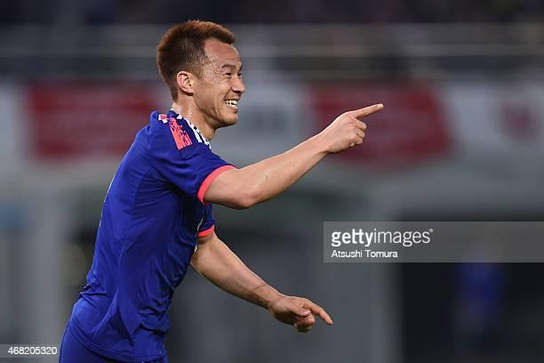 Shinji Okazaki of Japan celebrates after scoring his team's second goal during the international friendly match between Japan and Uzbekistan at...