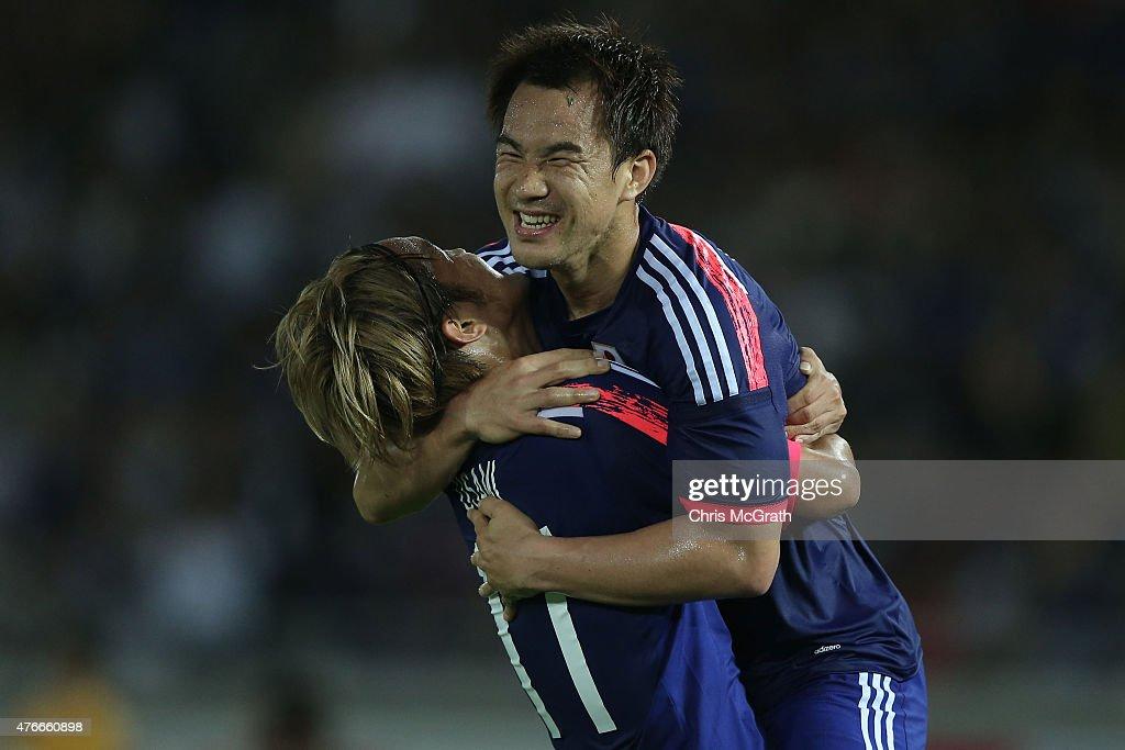 Shinji Okazaki of Japan celebrates scoring a goal with team mate Takashi Usami during the international friendly match between Japan and Iraq at...