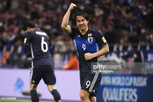 Shinji Okazaki of Japan celebrates scoring his team's first goal during the FIFA World Cup Russia Asian Qualifier second round match between Japan...