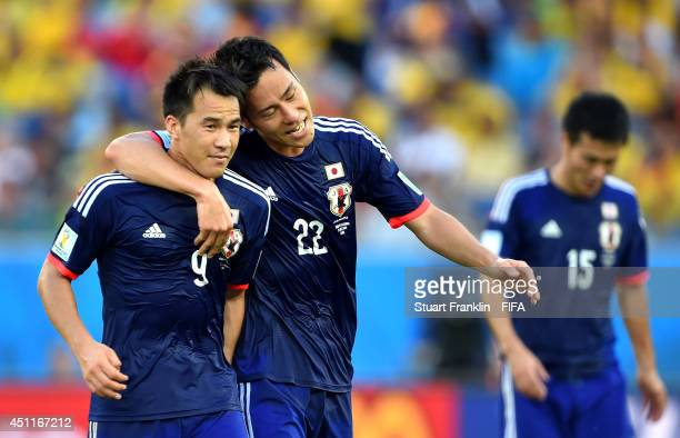 Shinji Okazaki of Japan celebrates scoring his team's first goal with his teammate Maya Yoshida during the 2014 FIFA World Cup Brazil Group C match...