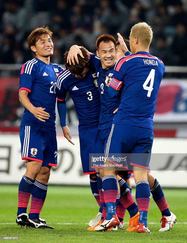 Shinji Okazaki (2nd R) of Japan celebrates scoring his team's second goal with his team mates Toshihiro Aoyama (1st L), Kosuke Ota (2nd L) and Keisuke Honda (1st R) during the international friendly match between Japan and Uzbekistan at Ajinomoto Stadium on March 31, 2015 in Chofu, Tokyo, Japan.
