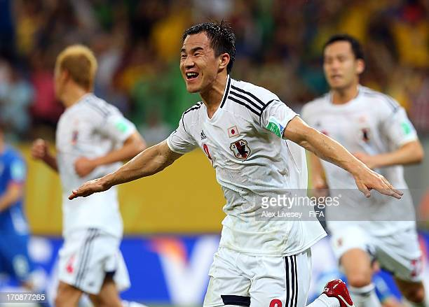 Shinji Okazaki of Japan celebrates scoring his team's third goal to make the score 33 during the FIFA Confederations Cup Brazil 2013 Group A match...