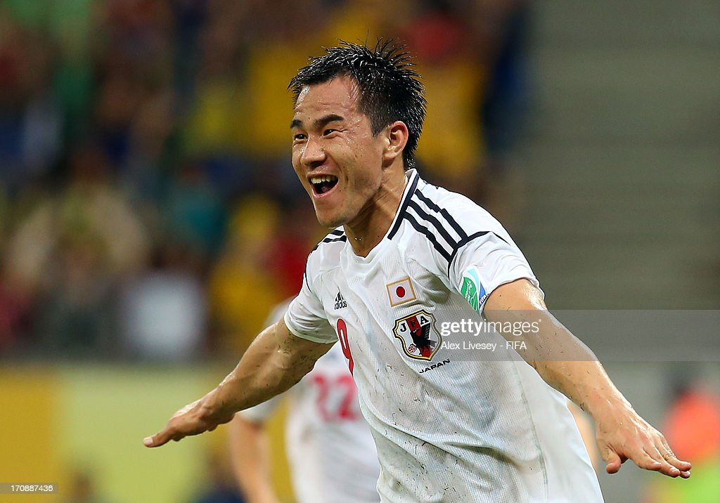 Shinji Okazaki of Japan celebrates scoring his team's third goal to make the score 3-3 during the FIFA Confederations Cup Brazil 2013 Group A match between Italy and Japan at Arena Pernambuco on June 19, 2013 in Recife, Brazil.