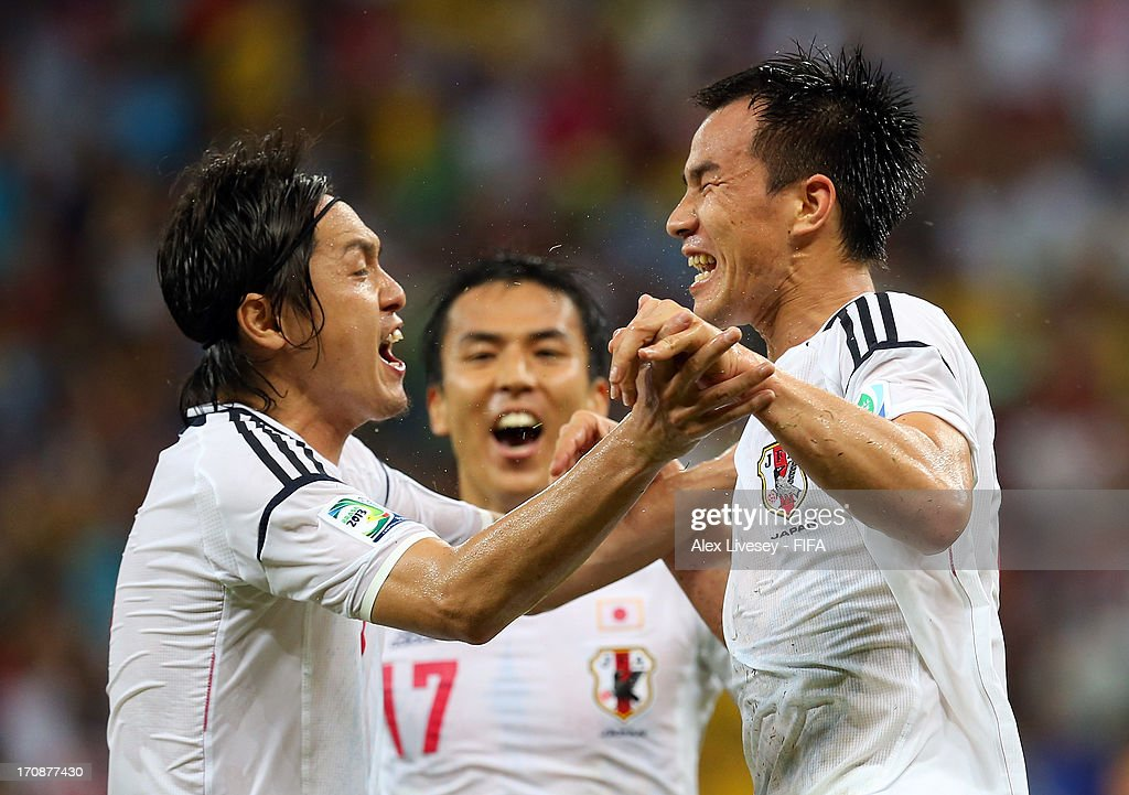 Shinji Okazaki of Japan (r) celebrates scoring his team's third goal with team-mate Yasuhito Endo to make the score 3-3 during the FIFA Confederations Cup Brazil 2013 Group A match between Italy and Japan at Arena Pernambuco on June 19, 2013 in Recife, Brazil.