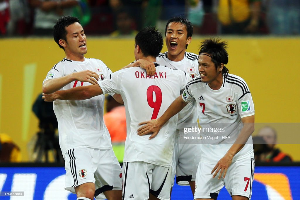 Shinji Okazaki of Japan (r) celebrates scoring his team's third goal with his team-mates to make the score 3-3 during the FIFA Confederations Cup Brazil 2013 Group A match between Italy and Japan at Arena Pernambuco on June 19, 2013 in Recife, Brazil.