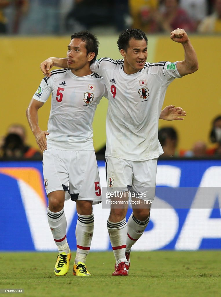Shinji Okazaki of Japan celebrates scoring his team's third goal with team-mate Yuto Nagatomo (L) to make the score 3-3 during the FIFA Confederations Cup Brazil 2013 Group A match between Italy and Japan at Arena Pernambuco on June 19, 2013 in Recife, Brazil.