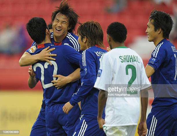 Shinji Okazaki of Japan celebrates scoring the first goal for Japan during the Asian Cup Group B match between Syria and Japan at Qatar Sports Club...