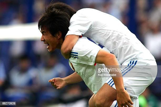 Shinji Okazaki of Japan celebrates the first goal during the 2010 FIFA World Cup qualifier match between Japan and Uzbekistan at Pakhtakor Markaziy...