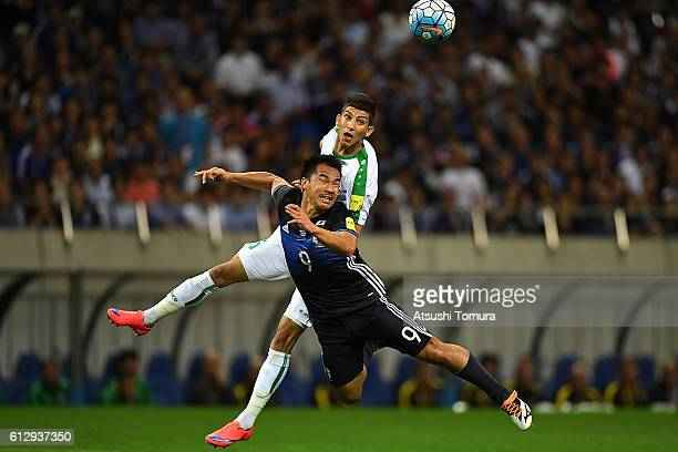 Shinji Okazaki of Japan competes for the ball during the 2018 FIFA World Cup Qualifiers match between Japan and Iraq at Saitama Stadium on October 6...