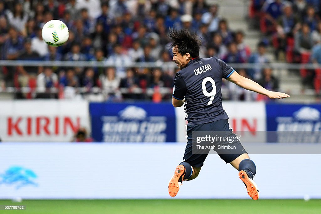 Shinji Okazaki of Japan heads the ball to score his team's first goal during the international friendly match between Japan and Bulgaria at the...