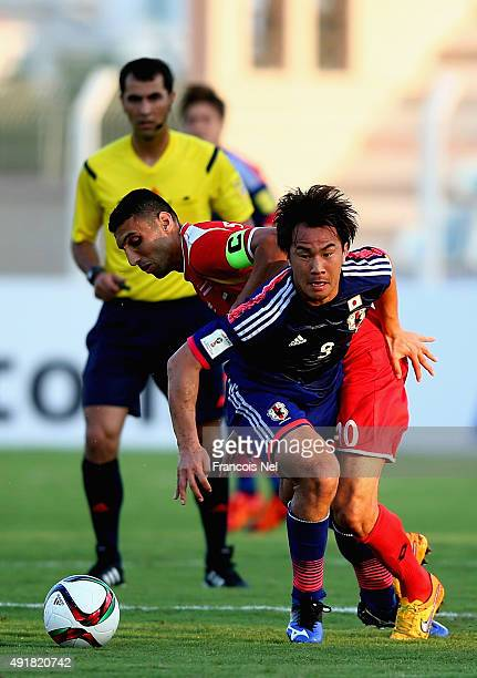 Shinji Okazaki of Japan in action during the 2018 FIFA World Cup Asian Group E qualifying match between Syria and Japan at Seeb Stadium on October 8...