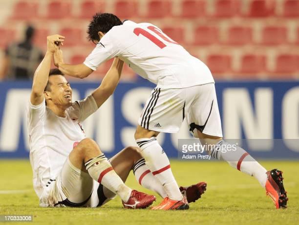 Shinji Okazaki of Japan is congratulated by Shinji Kagawa after he scored the winning goal during the FIFA World Cup Asian qualifier match between...