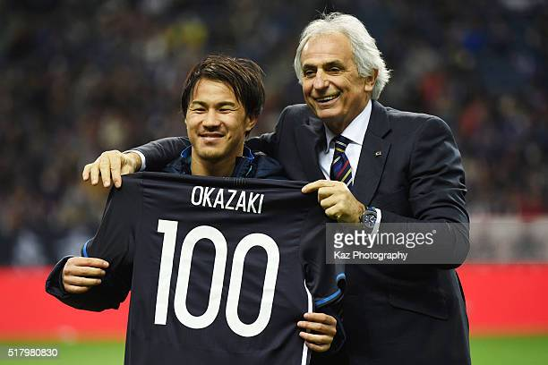 Shinji Okazaki of Japan poses for photographs with a shirt to mark his 100th appearance for the national team along with head coach Vahid Halilhodzic...