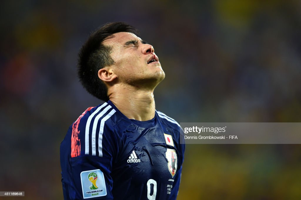 <a gi-track='captionPersonalityLinkClicked' href=/galleries/search?phrase=Shinji+Okazaki&family=editorial&specificpeople=4320771 ng-click='$event.stopPropagation()'>Shinji Okazaki</a> of Japan reacts during the 2014 FIFA World Cup Brazil Group C match between Japan and Colombia at Arena Pantanal on June 24, 2014 in Cuiaba, Brazil.