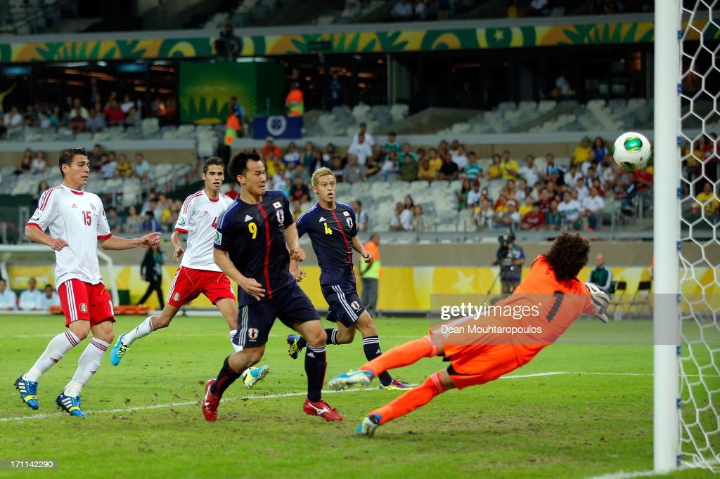 Shinji Okazaki of Japan scores a goal in the 86th minute past Guillermo Ochoa of Mexico during the FIFA Confederations Cup Brazil 2013 Group A match between Japan and Mexico at Estadio Mineirao on June 22, 2013 in Belo Horizonte, Brazil.