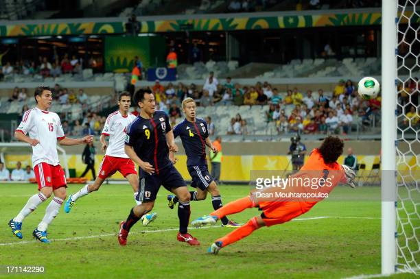 Shinji Okazaki of Japan scores a goal in the 86th minute past Guillermo Ochoa of Mexico during the FIFA Confederations Cup Brazil 2013 Group A match...