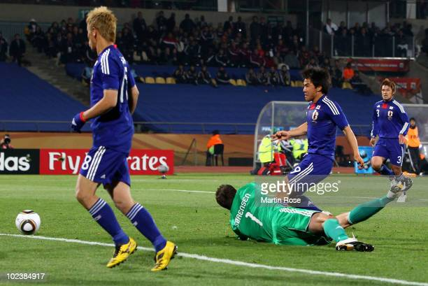 Shinji Okazaki of Japan scores his team's third goal during the 2010 FIFA World Cup South Africa Group E match between Denmark and Japan at the Royal...
