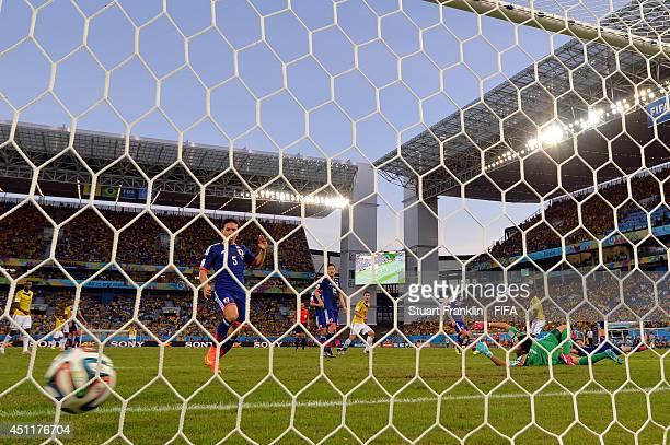 Shinji Okazaki of Japan scores the team's first goal during the 2014 FIFA World Cup Brazil Group C match between Japan and Colombia at Arena Pantanal...