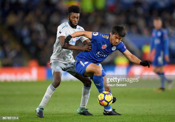 Shinji Okazaki of Leicester City and Beni Baningime of Everton battle for the ball during the Premier League match between Leicester City and Everton...