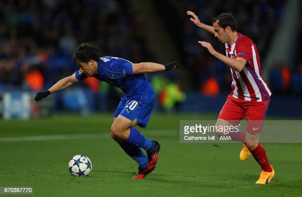 Shinji Okazaki of Leicester City and Diego Godin of Atletico Madrid during the UEFA Champions League Quarter Final second leg match between Leicester...