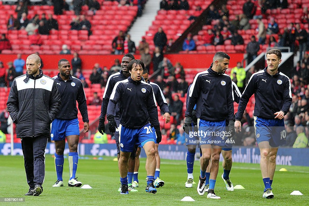 <a gi-track='captionPersonalityLinkClicked' href=/galleries/search?phrase=Shinji+Okazaki&family=editorial&specificpeople=4320771 ng-click='$event.stopPropagation()'>Shinji Okazaki</a> of Leicester City and his team-mates walk across the pitch during their warm up prior to the Barclays Premier League match between Manchester United and Leicester City at Old Trafford on May 1, 2016 in Manchester, United Kingdom.
