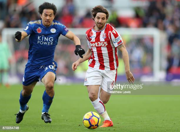 Shinji Okazaki of Leicester City and Joe Allen of Stoke City battle for possession during the Premier League match between Stoke City and Leicester...