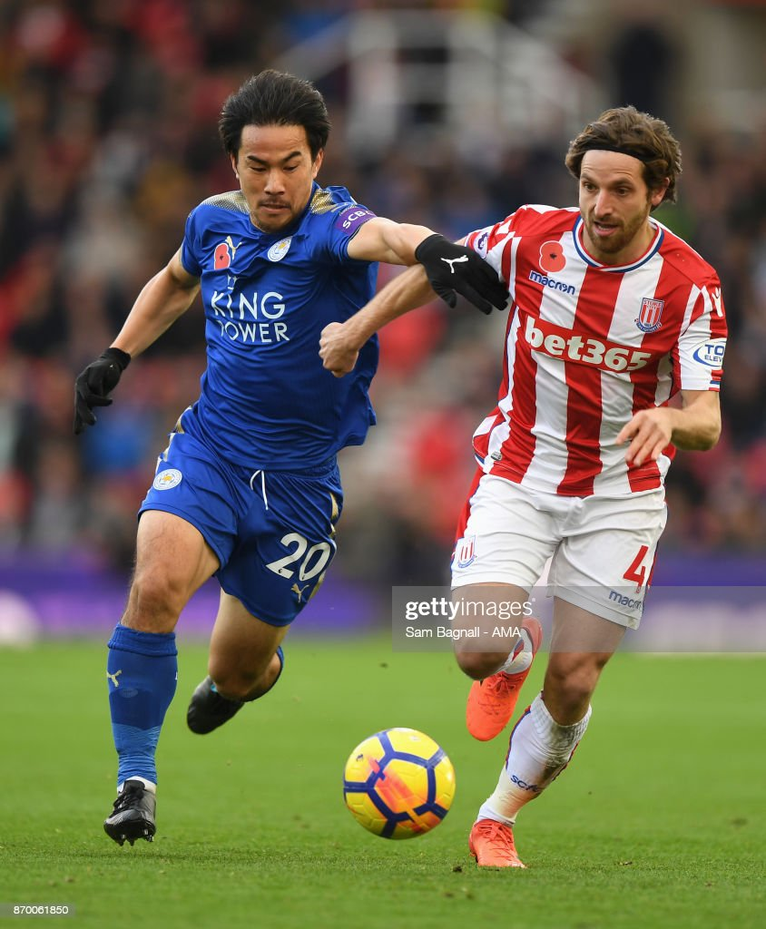 Shinji Okazaki of Leicester City and Joe Allen of Stoke City during the Premier League match between Stoke City and Leicester City at Bet365 Stadium on November 4, 2017 in Stoke on Trent, England.
