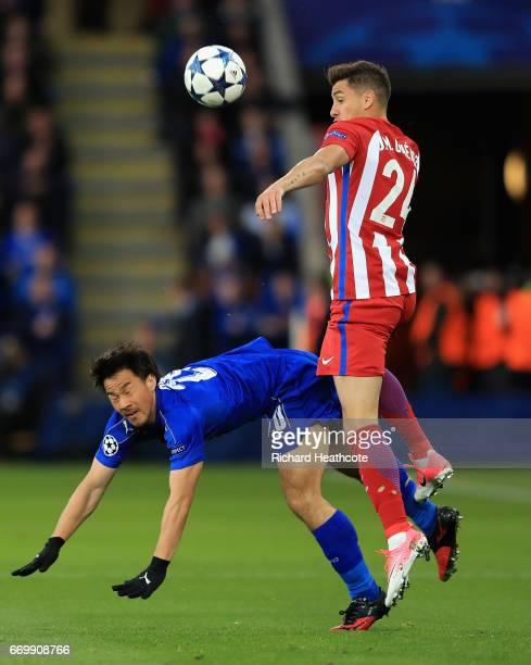 Shinji Okazaki of Leicester City and Jose Gimenez of Atletico Madrid battle for possession during the UEFA Champions League Quarter Final second leg...