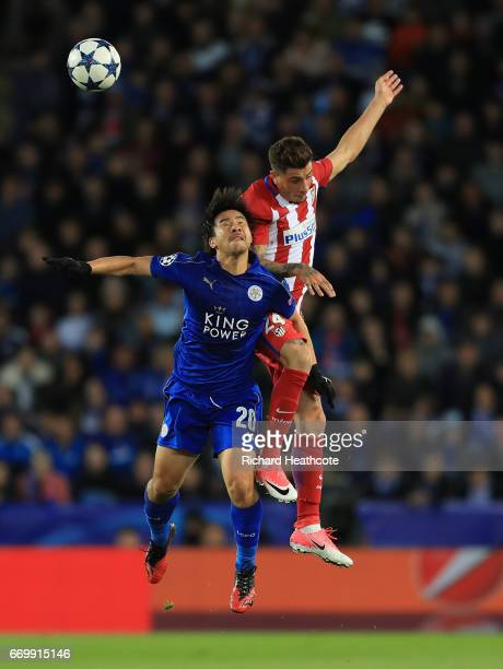 Shinji Okazaki of Leicester City and Jose Gimenez of Atletico Madrid battle to win a header during the UEFA Champions League Quarter Final second leg...
