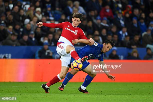 Shinji Okazaki of Leicester City and Marten de Roon of Middlesbrough compete for the ball during the Premier League match between Leicester City and...